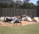 A partially reconstructed wall and some tents give a perspective on how the prisoner of war camp may have looked.
